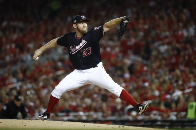 Washington Nationals starting pitcher Stephen Strasburg throws during the second inning of Game 3 of the baseball National League Championship Series against the St. Louis Cardinals Monday, Oct. 14, 2019, in Washington. (AP Photo/Patrick Semansky)