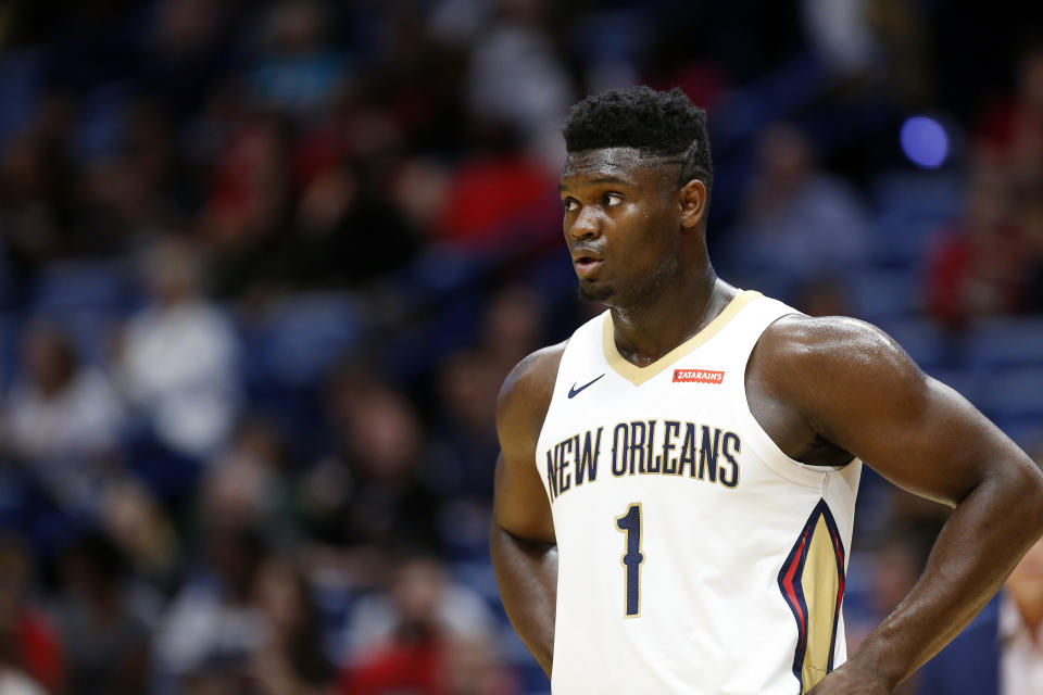 New Orleans Pelicans forward Zion Williamson (1) waits for play to resume in the first half of a preseason NBA basketball game against the Utah Jazz in New Orleans, Friday, Oct. 11, 2019. (AP Photo/Tyler Kaufman)