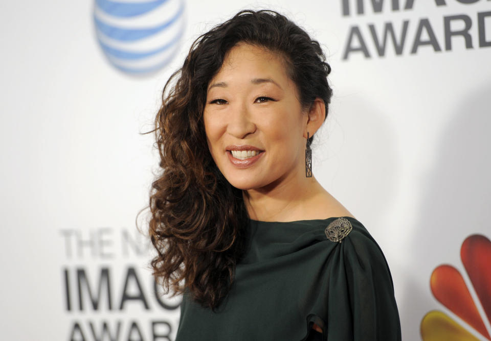 "FILE - In this Feb. 1, 2013 file photo, actress Sandra Oh arrives at the 44th Annual NAACP Image Awards at the Shrine Auditorium in Los Angeles. ABC says that ""Grey's Anatomy"" star Sandra Oh is leaving the medical drama after the coming season. Shonda Rhimes, the show's creator and executive producer, said she's grateful for what she called the actress' ""brilliant"" work. Rhimes said ""Grey's Anatomy"" will savor Oh's character of Dr. Cristina Yang in the upcoming 10th season, and then give her the exit she deserves. (Photo by Chris Pizzello/Invision/AP, File)"