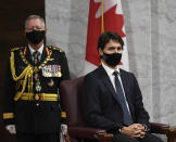 Chief of Defence Staff Jonathan Vance, left, and Canadian Prime Minister Justin Trudeau listen to Gov. Gen. Julie Payette deliver the throne speech in the Senate chamber in Ottawa, Ontario, on Wednesday, Sept. 23, 2020. (Adrian Wyld/The Canadian Press via AP)
