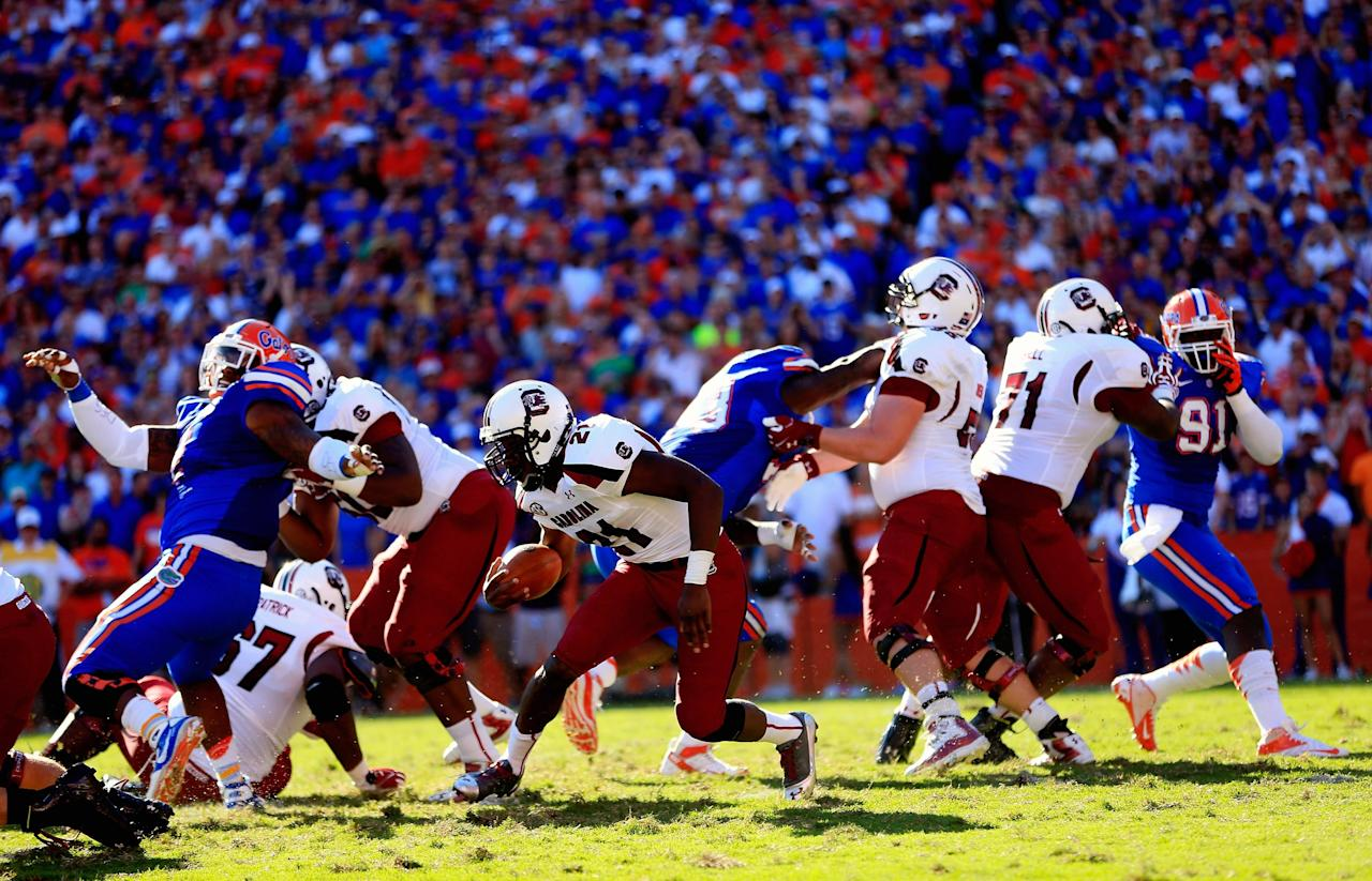 GAINESVILLE, FL - OCTOBER 20: Running back Marcus Lattimore #21 of the South Carolina Gamecocks rushes against the Florida Gators at Ben Hill Griffin Stadium on October 20, 2012 in Gainesville, Florida.  (Photo by Chris Trotman/Getty Images)