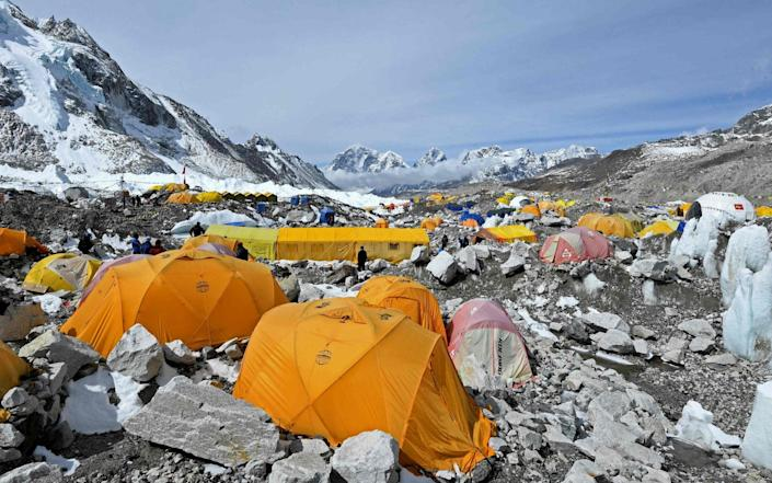 The warmer weather that ushers in safer conditions for scaling the world's highest mountain has coincided with a wave of Covid-19 infections in Nepal - AFP