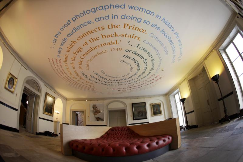 In this picture taken with a fish-eye lens, paintings, photographs and writing on the ceiling are displayed during a press preview at what used to be the official residence of the late Princess Diana, Kensington Palace in London, Tuesday, March 20, 2012.  Kensington Palace has been transformed following a 12 million pounds (US$19 million, euro14.4 million) restoration project timed to be completed  for this summer's Queen Elizabeth II's Diamond Jubilee and the London 2012 Olympics.  (AP Photo/Matt Dunham)