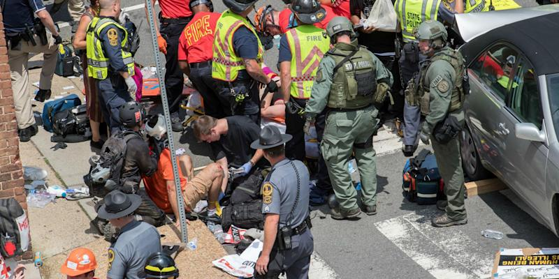 People receive first-aid after a car ran into a crowd of protesters in Charlottesville: Getty