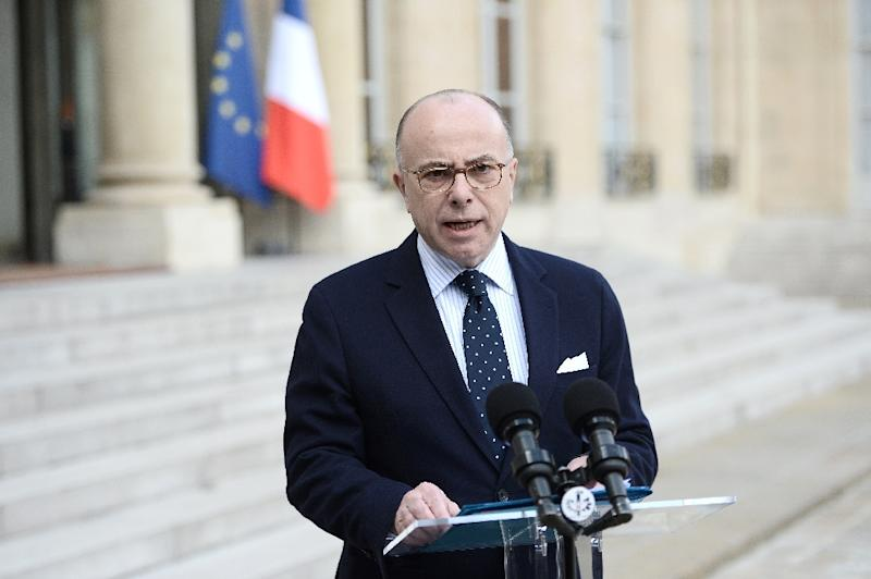 French Interior Minister Bernard Cazeneuve gives a statement after a meeting with the prime minister, defence minister and president at the Elysee Palace in Paris following the Brussels attacks on March 22, 2016