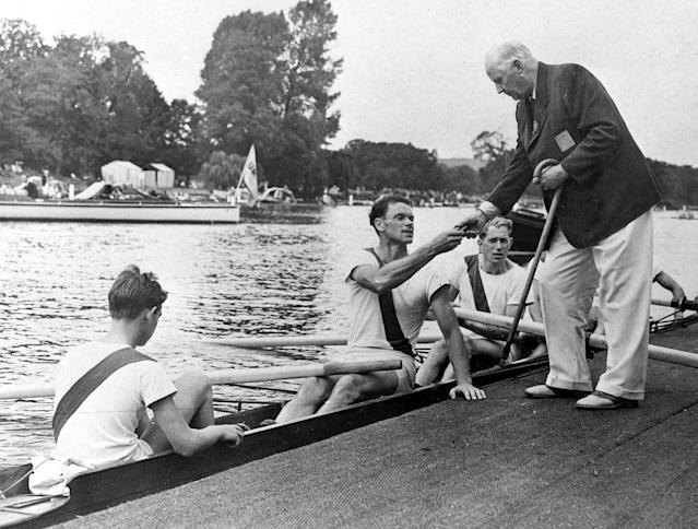 The crew of Denmark's boat receive their Olympic Games Coxed Four Rowing bronze medals, at a landing stage, at Henley-on-Thames, England, Aug. 9, 1948. Olympic President Johannes Sigfrid Edstroem is seen presenting the medals. All others are unidentified. (AP Photo)