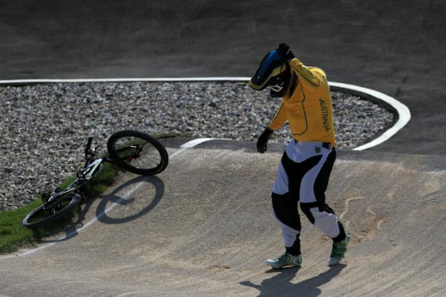 LONDON, ENGLAND - AUGUST 09: Khalen Young of Australia holds his head after crashing during the Men's BMX Cycling Quarter Finals on Day 13 of the London 2012 Olympic Games at BMX Track on August 9, 2012 in London, England. (Photo by Phil Walter/Getty Images)