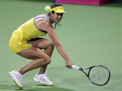 Ana Ivanovic of Serbia returns the ball during her match against Tamira Paszek of Austria on the first day of the WTA Qatar Ladies Open in Doha, Qatar, Monday, Feb. 11, 2013. (AP Photo/Osama Faisal)