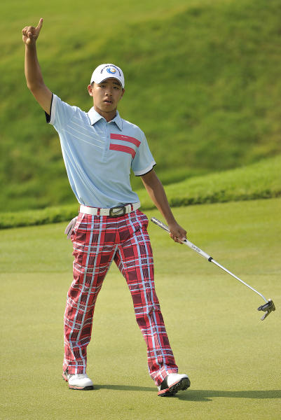 Guan Tianlang of China reacts during the final round of the Asia-Pacific Amateur Championship golf at Amata Spring Country Club, in Chonburi, Thailand Sunday, Nov. 4, 2012. (AP Photo/AAC, Paul Lakatos) NO LICENSING