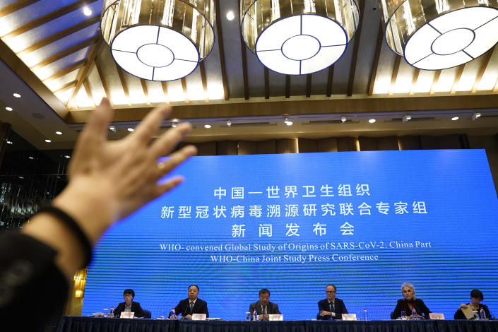 FILE - In this Feb. 9, 2021, file photo, journalist raises her hand to ask a question at the WHO-China Joint Study Press Conference held at the end of the World Health Organization mission in Wuhan, China. As the World Health Organization draws up plans for the next phase of its probe of how the coronavirus pandemic started, an increasing number of scientists say the U.N. agency it isn't up to the task and shouldn't be the one to investigate. Numerous experts, some with strong ties to WHO, say that political tensions between the U.S. and China make it impossible for an investigation by the agency to find credible answers. (AP Photo/Ng Han Guan, File)