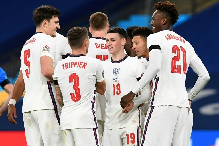 England midfielder Phil Foden (C) celebrates with team-mates after scoring against Iceland