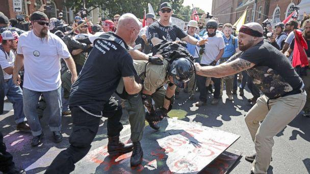 PHOTO: White nationalists, neo-Nazis, the KKK and members of the 'alt-right' attack each other as a counter protester (R) intervenes during the melee outside Emancipation Park during the Unite the Right rally, Aug. 12, 2017, in Charlottesville, Va. (Chip Somodevilla/Getty Images, FILE)