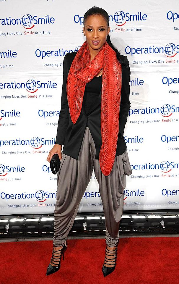 """Love Sex Magic"" songstress Ciara rarely hits a bad note, but she most definitely did at a recent charity fete in a monstrous snakeskin scarf, Hammer pants, and super strappy patent pumps. Dimitrios Kambouris/<a href=""http://www.wireimage.com"" target=""new"">WireImage.com</a> - May 7, 2009"