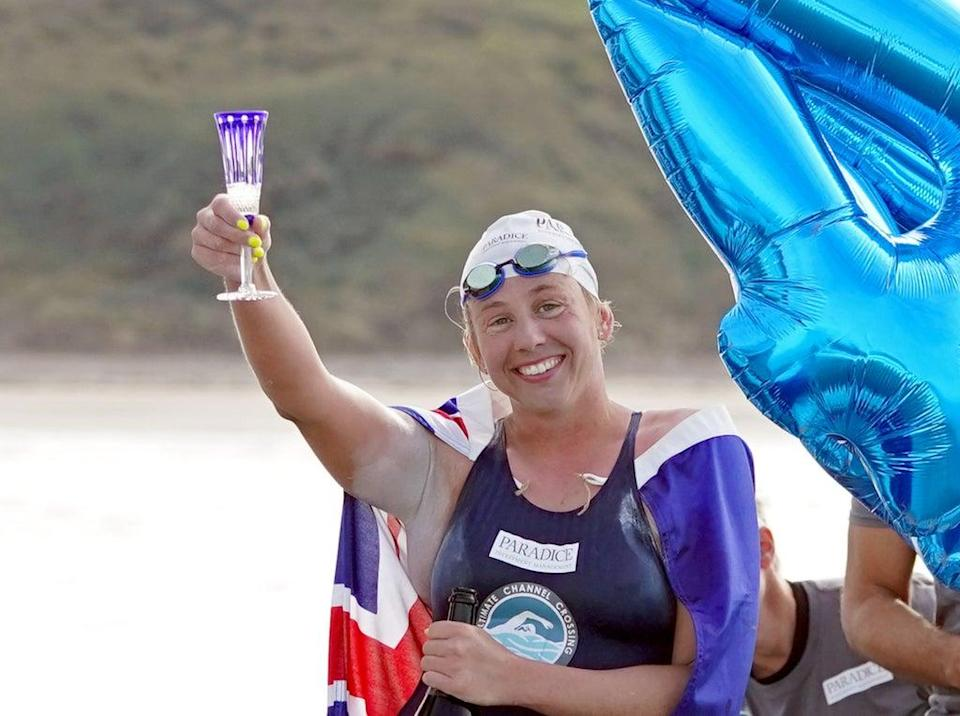 Australian endurance swimmer Chloe McCardel raises as glass after completing her 44th swim across the English Channel (Gareth Fuller/PA) (PA Wire)