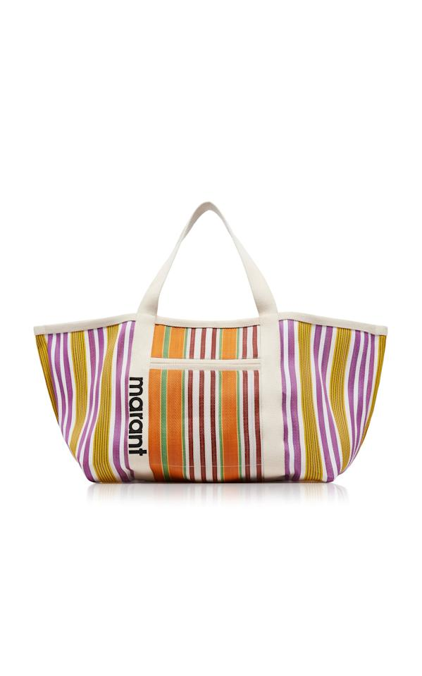 """<p>If you're in the market for a bag that's bigger than you, the <a href=""""https://www.popsugar.com/buy/Isabel-Marant-Warden-Striped-Shell-Tote-552768?p_name=Isabel%20Marant%20Warden%20Striped%20Shell%20Tote&retailer=modaoperandi.com&pid=552768&price=285&evar1=fab%3Aus&evar9=35939418&evar98=https%3A%2F%2Fwww.popsugar.com%2Ffashion%2Fphoto-gallery%2F35939418%2Fimage%2F47265772%2FIsabel-Marant-Warden-Striped-Shell-Tote&list1=shopping%2Caccessories%2Cbags&prop13=mobile&pdata=1"""" rel=""""nofollow"""" data-shoppable-link=""""1"""" target=""""_blank"""" class=""""ga-track"""" data-ga-category=""""Related"""" data-ga-label=""""https://www.modaoperandi.com/isabel-marant-ss20/warden-striped-shell-tote?size=OS"""" data-ga-action=""""In-Line Links"""">Isabel Marant Warden Striped Shell Tote</a> ($285) is your best bet. It's so stylish, but can still fit everything you need.</p>"""