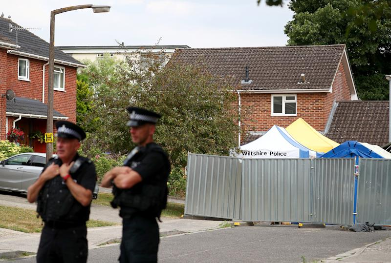 Police officers stand on duty outside Sergei Skripal's home in Salisbury Britain