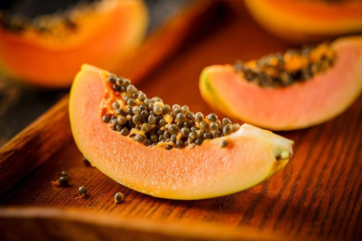 """<p>This sweet and juicy fruit is one of Dr. Farhadi's top picks for constipation. """"Papaya is another fruit that is high in fiber—one medium papaya has 5 grams,"""" says Keri Gans, R.D., author of <em><a href=""""https://www.amazon.com/Small-Change-Diet-Thinner-Healthier/dp/B0058M64GO?tag=syn-yahoo-20&ascsubtag=%5Bartid%7C10050.g.35715333%5Bsrc%7Cyahoo-us"""" rel=""""nofollow noopener"""" target=""""_blank"""" data-ylk=""""slk:The Small Change Diet"""" class=""""link rapid-noclick-resp"""">The Small Change Diet</a></em>. It also offers a dose of <a href=""""https://www.prevention.com/food-nutrition/healthy-eating/g20499990/calcium-rich-foods/"""" rel=""""nofollow noopener"""" target=""""_blank"""" data-ylk=""""slk:calcium"""" class=""""link rapid-noclick-resp"""">calcium</a>, magnesium, and <a href=""""https://www.prevention.com/food-nutrition/a20466110/13-foods-that-have-more-potassium-than-a-banana/"""" rel=""""nofollow noopener"""" target=""""_blank"""" data-ylk=""""slk:potassium"""" class=""""link rapid-noclick-resp"""">potassium</a>.</p>"""