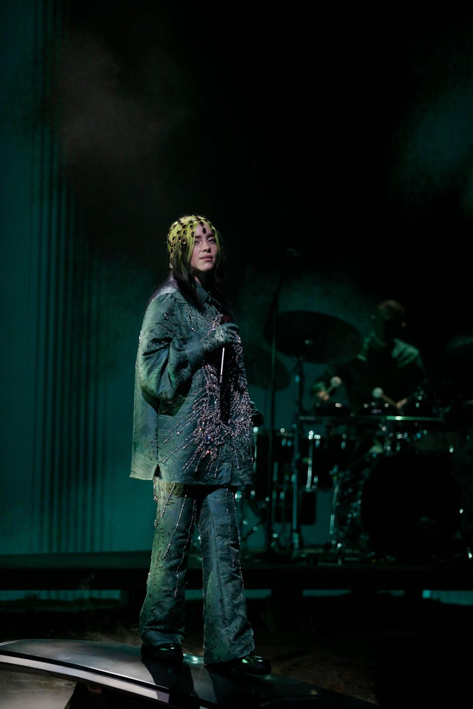"""<h2>Billie Eilish in Gucci</h2><br>Her second look — a stunning, sea creature-esque, green look by Gucci — didn't disappoint either. <span class=""""copyright"""">Photo: Francis Specker/CBS via Getty Images.</span>"""