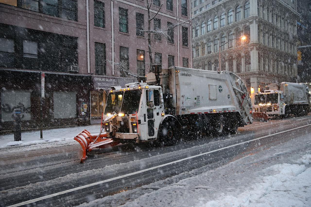 <p>New York City Sanitation Department snowplows clear Broadway during a snowstorm in the city on March 7, 2018. (Photo: Gordon Donovan/Yahoo News) </p>