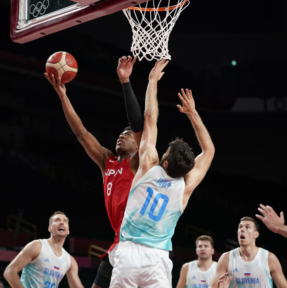 Japan's Rui Hachimura (8) shoots over Slovenia's Mike Tobey (10) during men's basketball preliminary round game at the 2020 Summer Olympics, Thursday, July 29, 2021, in Saitama, Japan. (AP Photo/Charlie Neibergall)