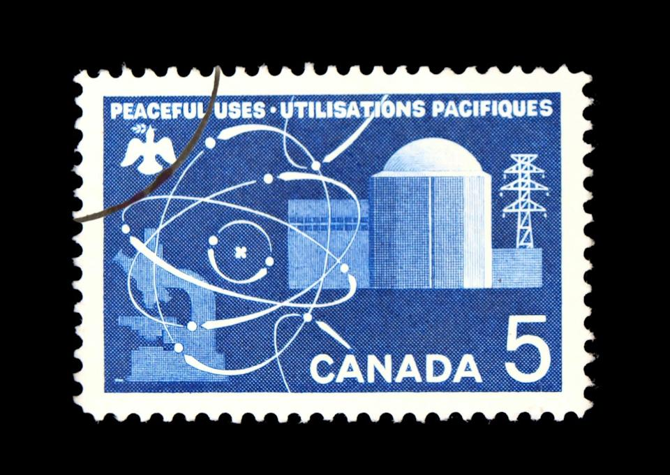 A blue and white stamp that reads PEACEFUL USES UTILISATIONS PACIFIQUES