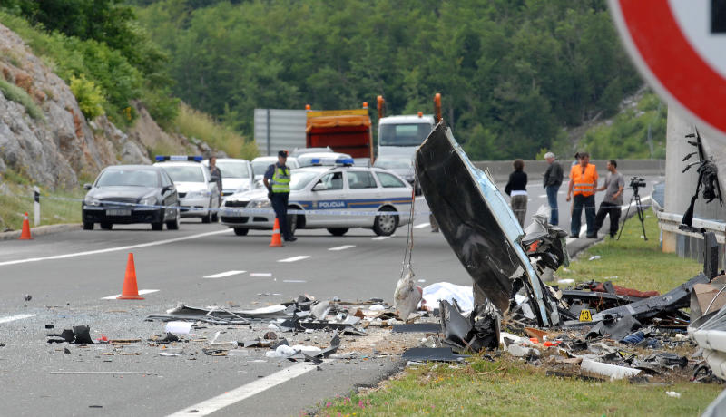 Police survey the scene of the bus crash near Gospic, Croatia, Saturday, June 23, 2012. At least seven Czech tourists were killed and 44 injured in a bus crash on a major highway in Croatia early Saturday, police said. The accident happened some 200 kilometers (124 miles) south of Zagreb, on the highway connecting the Croatian capital with the central Adriatic coastal city of Split. (AP Photo)