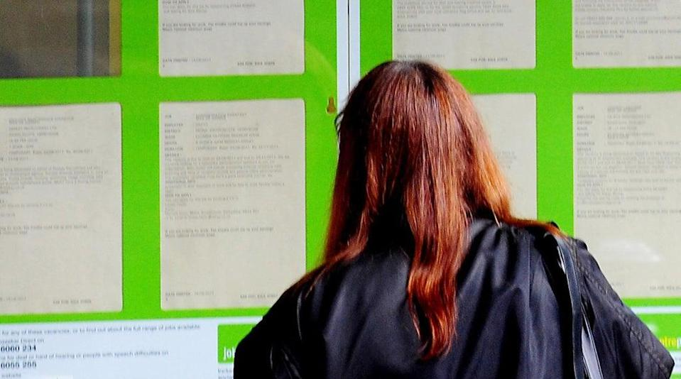 A woman looking into the window of a job centre (Rui Vieira/PA) (PA Archive)