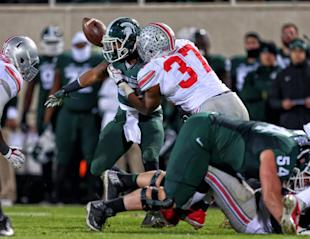 Spartans RB Jeremy Langford (33) has the ball knocked away CB Damon Webb. (USA TODAY Sports)