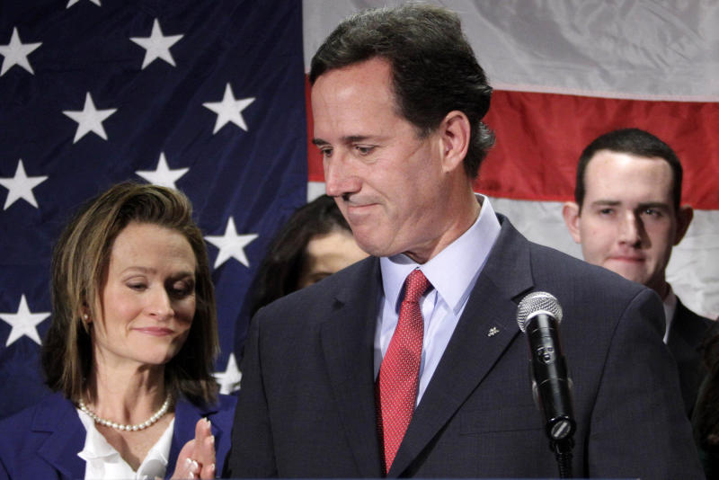 Former Pennsylvania Sen. Rick Santorum turns to his wife Karen, left, after announcing he is suspending his candidacy for the presidency, Tuesday, April 10, 2012, in Gettysburg, Pa. (AP Photo/Gene J. Puskar)