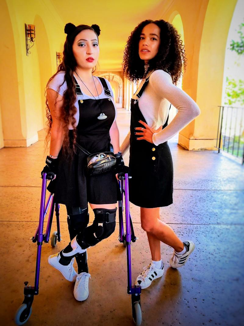 Drewy NovaClara Curious with her crutches and her friend posing together.