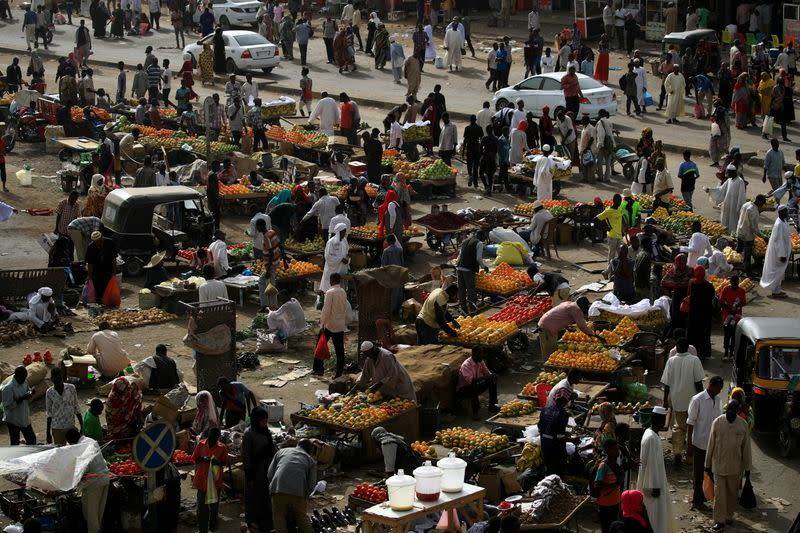 FILE PHOTO: Sudanese residents shop in a bazaar in Khartoum