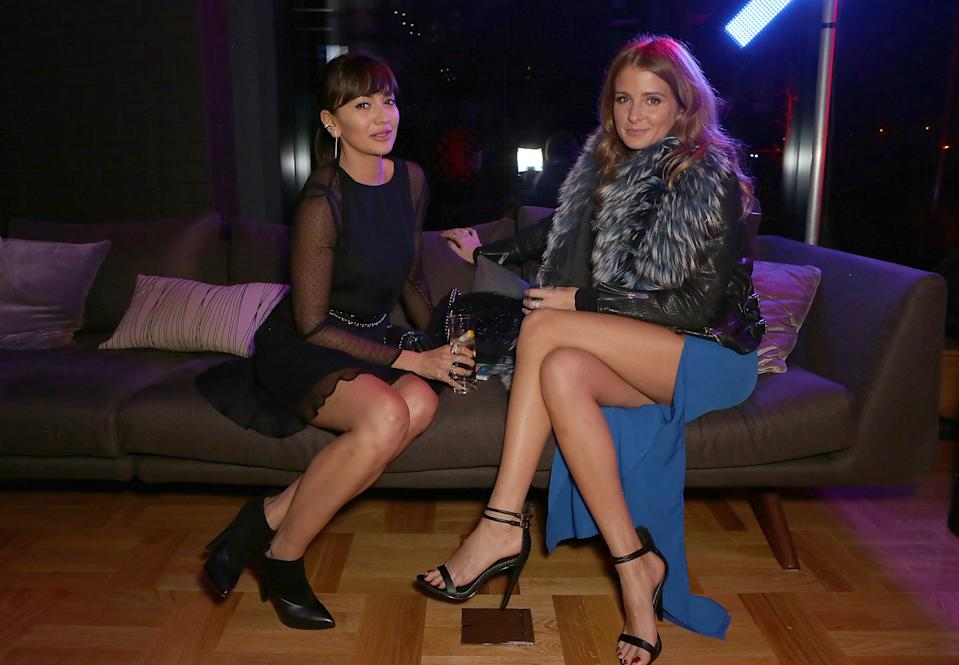 """LONDON, ENGLAND - NOVEMBER 26: Zara Martin and Millie Mackintosh attend an exclusive party to celebrate the imminent arrival of """"City Island by Ballymore"""" - a new island neighbourhood for London which will provide an important link between Canning Town and the City - at City Island on November 26, 2014 in London, England. (Photo by David M. Benett/Getty Images for Ballymore)"""