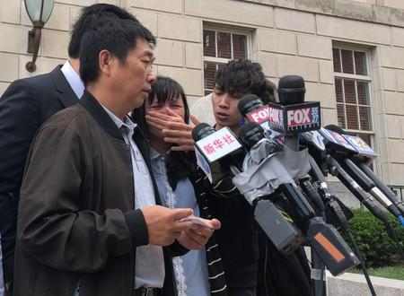 Ronggao Zhang reads a statement outside U.S. District court in Peoria, Illinois