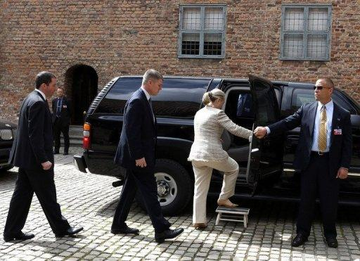 US Secretary of State Hillary Clinton surrounded by security personnel leaving after a lunch at Akershus Castle in Oslo on June 1. Clinton flew to Tromsoe in the Arctic Circle to see first hand the way climate change is opening a once frozen region to competition for vast oil reserves