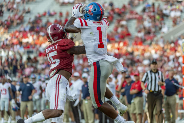 Mississippi wide receiver Jonathan Mingo (1) grabs a touchdown pass over Alabama defensive back Xavier McKinney (15) during the second half of an NCAA college football game, Saturday, Sept. 28, 2019, in Tuscaloosa, Ala. (AP Photo/Vasha Hunt)