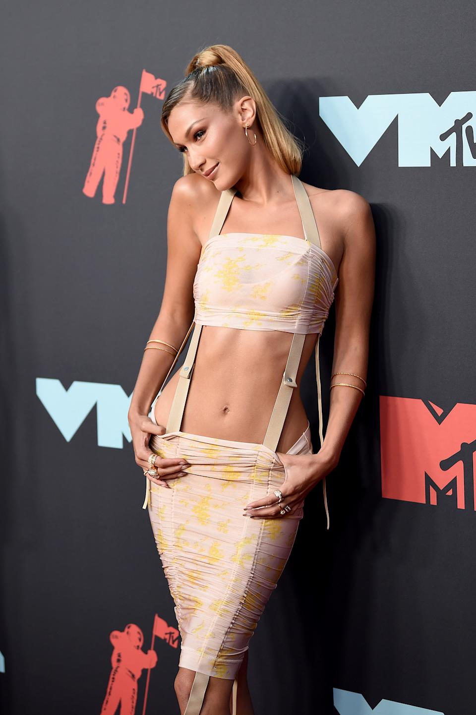 """<h1 class=""""title"""">Bella Hadid with a Jimmy Choo clutch and Chrome Hearts jewelry</h1><cite class=""""credit"""">Photo: Getty Images</cite>"""