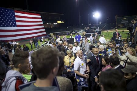 Supporters greet Democratic victor for Pennsylvania Governor Tom Wolf at his primary election night party in Santander Stadium in York