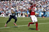 Arizona Cardinals wide receiver Christian Kirk (13) catches a 26-yard touchdown pass ahead of Tennessee Titans cornerback Elijah Molden, left, in the second half of an NFL football game Sunday, Sept. 12, 2021, in Nashville, Tenn. (AP Photo/Wade Payne)