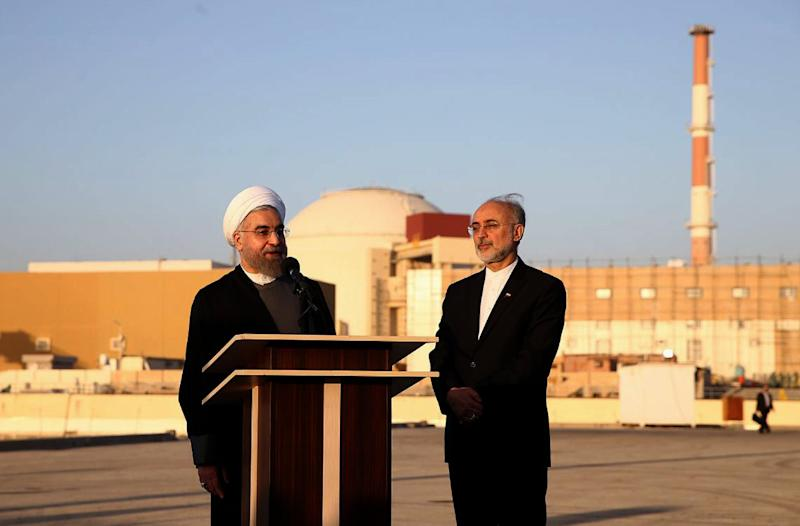In this file photo released on Jan. 13, 2015, Iranian President Hassan Rouhani, left, and Iran's nuclear chief Ali Akbar Salehi, address journalists at the Bushehr nuclear power plant in the Gulf port city of Bushehr, Iran.