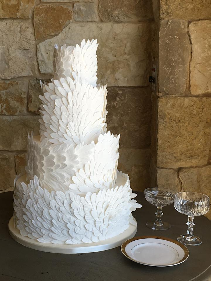 """<p>Intricate handmade details are what really set a cake apart. """"This cake features over 1,200 individual sugar feathers, embossed with texture and artfully placed on each tier,"""" Bailey describes. Again, it proves that an all-white cake doesn't have to be boring! """"Dimension and movement keep cake designs visually captivating,"""" she says.</p>"""