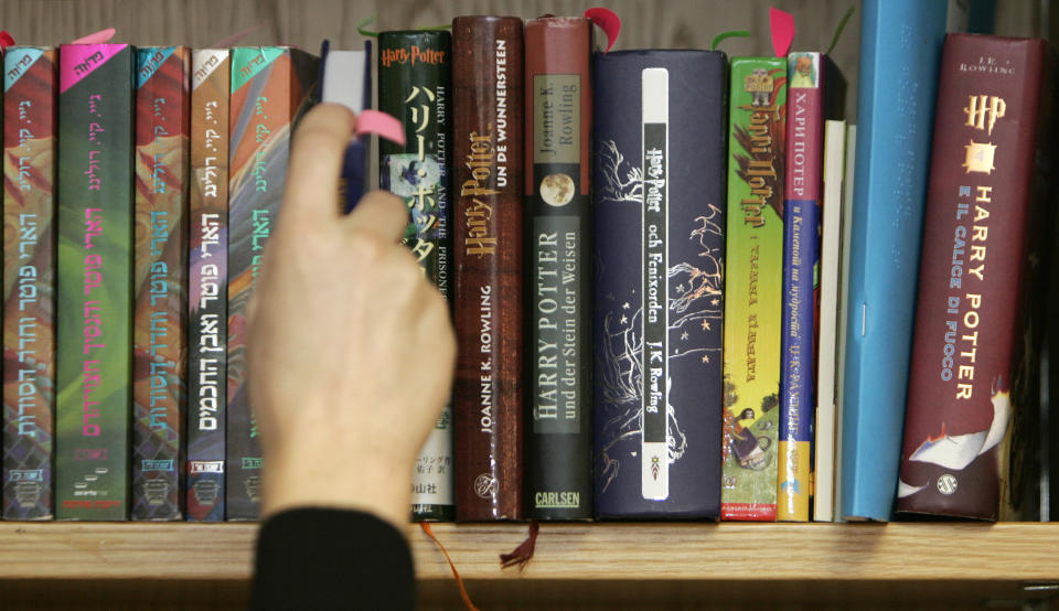 Books that make up part of an auction lot containing 550 international copies of works in the Harry Potter series are seen on a shelf at Bloomsbury Auctions in London February 26, 2008. Described as an 'extraordinary collection' of a private collector, it contains 67 different languages with some first edition and rare proof copies, will be auctioned this Thursday.       REUTERS/Luke MacGregor   (BRITAIN)