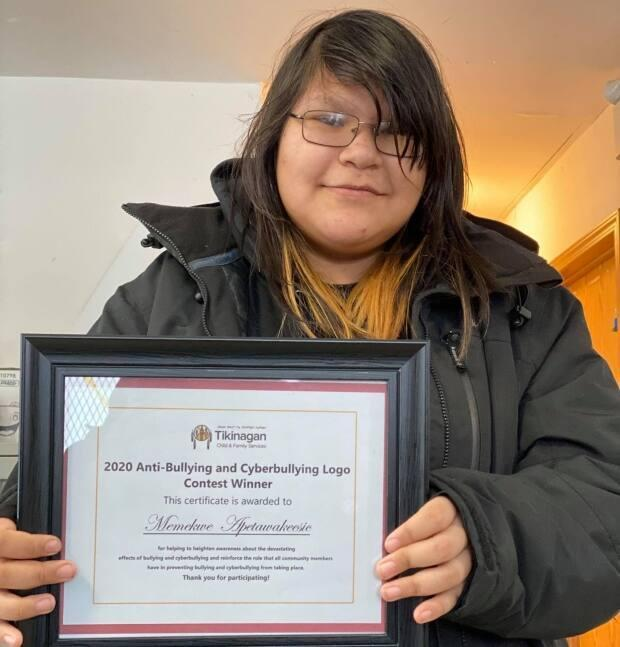 Memekew, shown with her certificate from Tikinagan Child and Family Services, says she was reluctant to enter the contest but her parents encouraged her to do so.