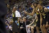 Oregon guard Johnathan Loyd (10), forward Ben Carter (32), forward Arsalan Kazemi (14) and center Tony Woods (55) react as guard Damyean Dotson, not shown, hits a 3-pointer against Saint Louis during their third-round game in the NCAA college basketball tournament, Saturday, March 23, 2013, in San Jose, Calif. Oregon won 74-57. (AP Photo/The Oregonian, Bruce Ely)