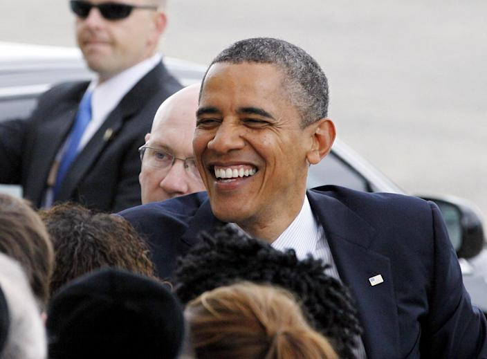 President Barack Obama shakes hands with people as he arrives at JFK International Airport in New York, Monday, June, 4, 2012, on his way to a visit in New York City where he will attend several campaign fundraisers.  (AP Photo/David Karp)