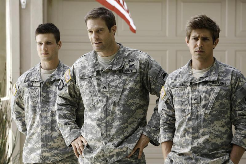 """This undated publicity photo released by Fox shows, from left, Parker Young, Geoff Stults and Chris Lowell, starring in the comedy """"Enlisted."""" Fox said Thursday, Sept. 12, 2013, it's moving the premiere of the new sitcom to January 2014. (AP Photo/Fox, Jordin Althaus)"""