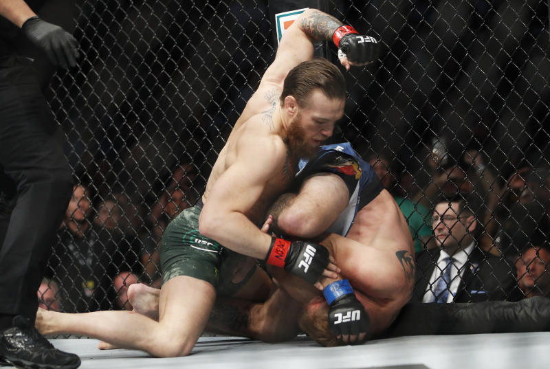 """Conor McGregor, left, fights Donald """"Cowboy"""" Cerrone during a UFC 246 welterweight mixed martial arts bout Saturday, Jan. 18, 2020, in Las Vegas. (AP Photo/John Locher)"""