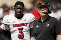 Louisville head coach Scott Satterfield and quarterback Malik Cunningham watch a replay during the first half of an NCAA college football game against Wake Forest on Saturday, Oct. 2, 2021, in Winston-Salem, N.C. (AP Photo/Chris Carlson)