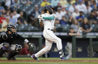 Seattle Mariners' J.P. Crawford hits an RBI single against the Colorado Rockies during the fifth inning of a baseball game, Tuesday, June 22, 2021, in Seattle. (AP Photo/John Froschauer)