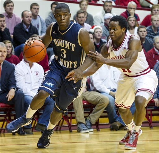 Mount St. Mary's Sam Prescott (3) drives the ball along the baseline past Indiana's Kevin Ferrell during the first half of an NCAA college basketball game, Wednesday, Dec. 19, 2012, in Bloomington, Ind. (AP Photo/Doug McSchooler)
