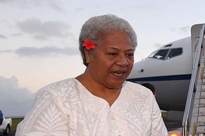 Then Deputy Prime Minister of Samoa Fiame Naomi Mata'afa speaks with Australian Prime Minister Malcolm Turnbull and the Australian High Commissioner to Samoa Sue Langford as they arrive at Faleolo Airport in Apia, Samoa on Sept. 8, 2017. More than three months after winning an election which sparked a constitutional crisis, Samoa's first female prime minister was finally able to take office on Tuesday, July 27, 2021. (Lukas Coch/AAP Image via AP)